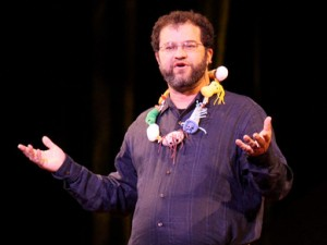 Jonathan Eisen wearing plastic microbes during his Ted Talk!