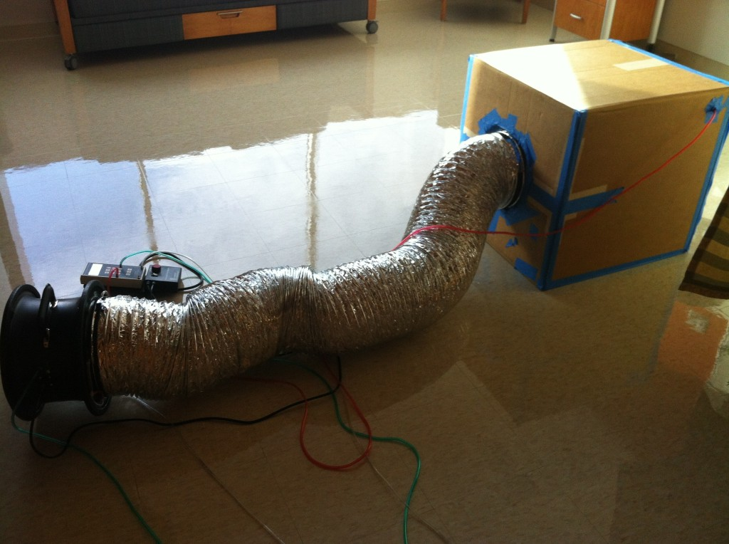 Tools of a building scientist: cardboard, tape, tubes...